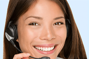 A woman with a headset answering customer service questions
